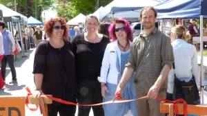 Photo by Marni Walsh (Left to right) Farmers' Market Committee Jodi Jones, Shawnette Crouse, A.J. Cavey, and Chair Joe Lemieux cut the ribbon to officially open the market on Thursday June 21st at First and Owen Sound Street. The market moved into the downtown core of Shelburne to become more accessible to residents and increase business traffic. Joe Lemieux reported a very successful start to the season with excellent crowds and receipts. Vendor's produce included baked goods, meats, fresh vegetables, maple syrup, honey, Indian cuisine, catering, crafts, art, and balloon and face painting for the kids.